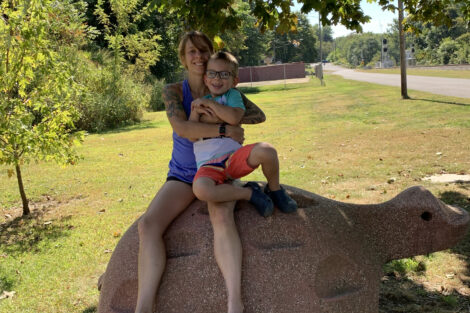 Greta and Grant on an outdoor concrete turtle in 2019