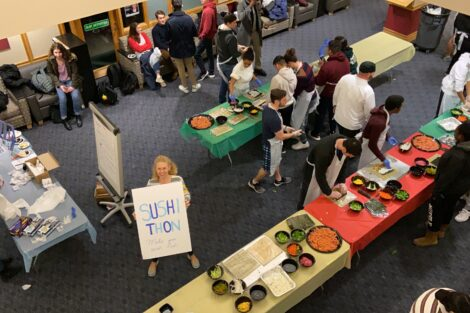 Janine Block holds at sign for the ISA's Sushithon