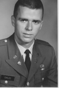 Retired psychology professor Alan Childs in a black-and-white photo wearing his Army uniform