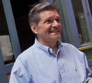 Larry Stockton, head of the music department, wearing a blue button-down shirt