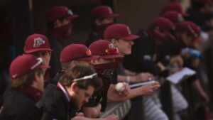 Lafayette baseball players sitting in the dugout during a game