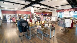 Interior view of the College Store, wtih clothing and other items for sale.