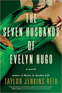 The cover of the book The Seven Husbands of Evelyn Hugo, with a woman wearing a green dress laying down