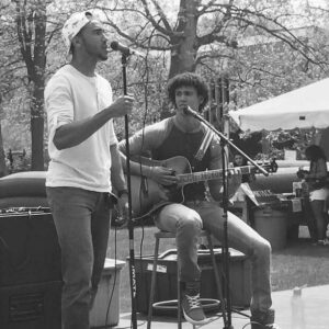 Brothers Jordan and Cory Dandy perform an acoustic set outdoors.