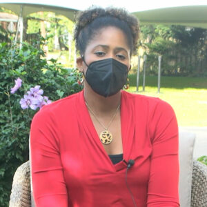 Sherryta Freeman talks in a video while wearing a medical mask.