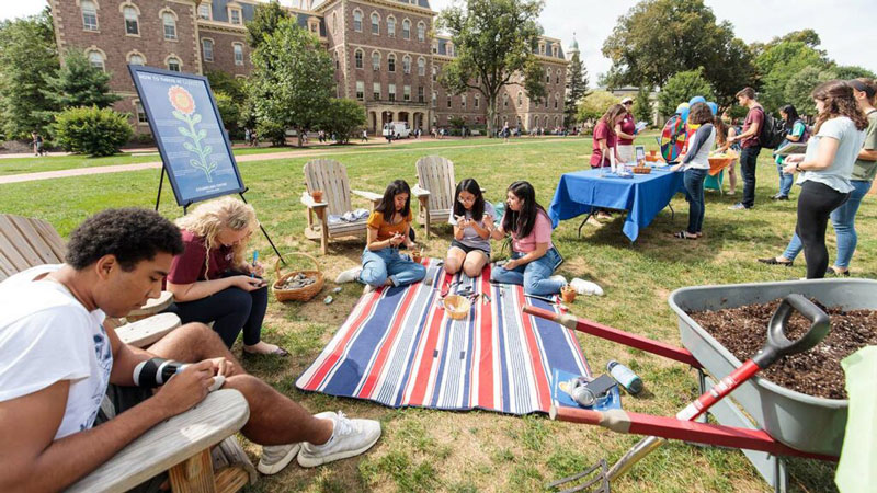 Students write messages and do other activities in the Counseling Center and LaFarm-sponsored Thrive event on the Quad,